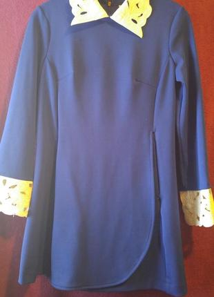 Стильное синее платье фирмы behcetti