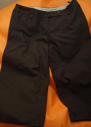 Удлиненные шорты атмосфера, состав шерсть, р-р 16, состояние отличное. пот 45, длина 79\55, поб 64,