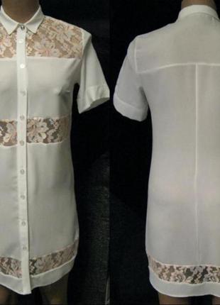 Блузка отделанная кружевами