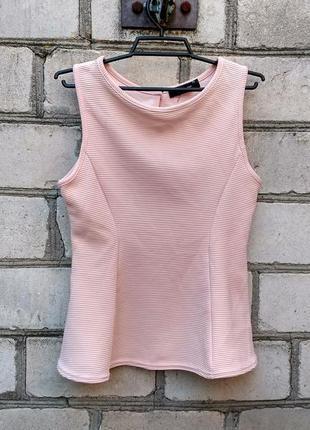 Персиковая блуза в рубчик с баской