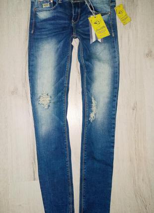 Брендовые синие джинсы alcott с дырками