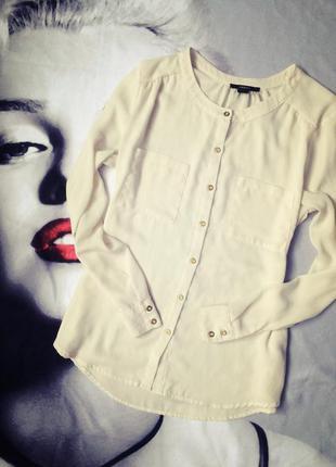 Блуза свободного кроя без воротника