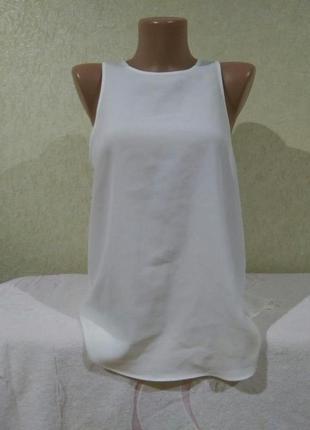 Отличная блуза на пуговицах сзади