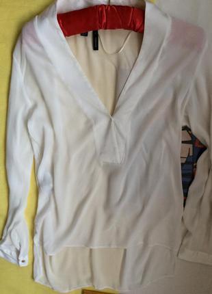 Білосніжна блуза з подовженим задом mango