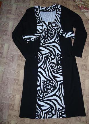 Красивое черно-белое женское платье c болеро