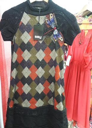 Нарядное необычное платье от извесного бренда