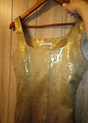 Шикарное коктейльное платье с тиснением