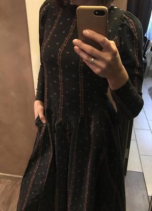 Эффектное платье с карманами