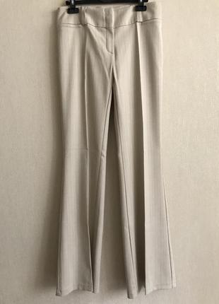 Золотистые брюки в тонкую коричневую полоску