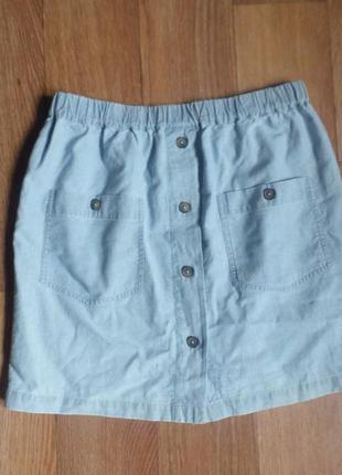 Трендовая юбка с пуговицами под джинс