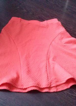 Яркая оранжевая юбочка