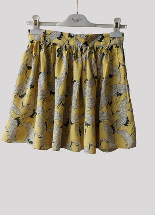 Желтая юбка с аистами