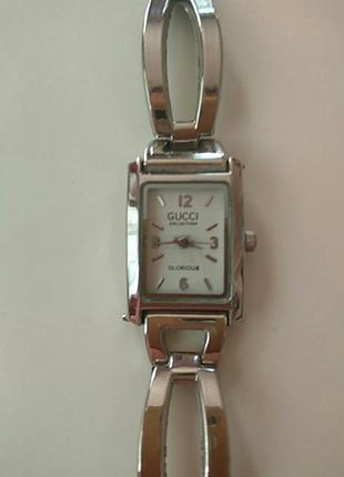 Модные часы gucci.