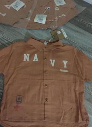 Стильная рубашка с надписью кирпичного цвета. есть разные размеры и цвета. новые.
