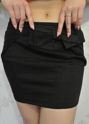 Чорна міні-юбка з бантиком  м-л