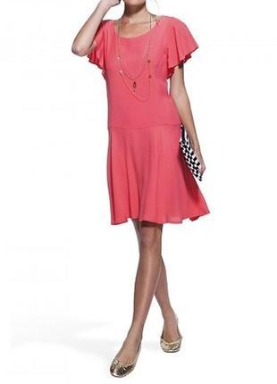 Яркое летнее коктейльное расклешенное платье миди кораллового цвета