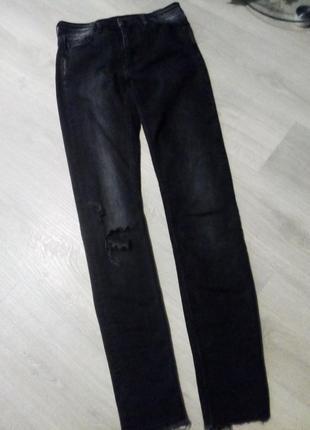 Брендовые брюки джинсы рваный низ3 фото