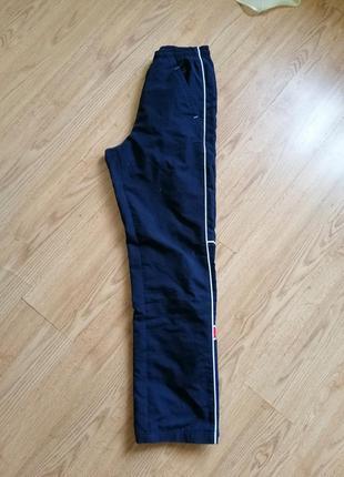 Утепленные штаны брюки від reebok с лампасамы