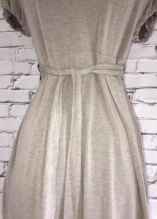 Платье бежевое с цветком4 фото