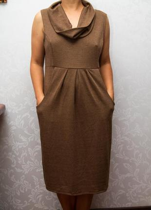 Элегантное платье с карманами.