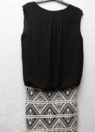 Мини платье с узкой юбкой и свободным верхом.9 фото