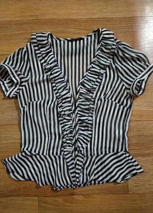 Блуза а черно-белую полоску1 фото
