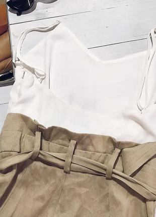 Актуальный комбинезон шортиками нежного цвета от dennis3 фото