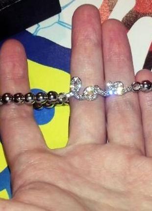 Браслет из бусин с шармом серебряного цвета с надписью love5 фото