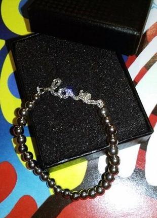 Браслет из бусин с шармом серебряного цвета с надписью love9 фото