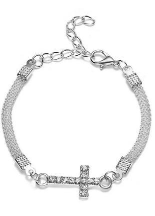 Стильный элегантный браслет со стразами серебристый с крестиком