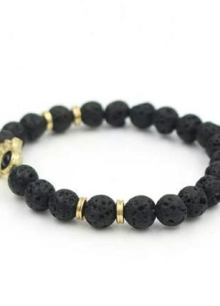 Стильный браслет с лавой черного цвета с шармом рука с глазом7 фото