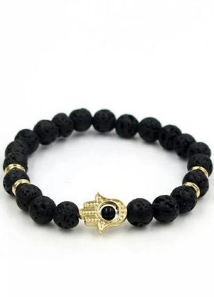 Стильный браслет с лавой черного цвета с шармом рука с глазом1 фото