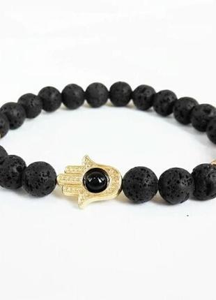 Стильный браслет с лавой черного цвета с шармом рука с глазом2 фото