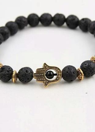 Стильный браслет с лавой черного цвета с шармом рука с глазом8 фото
