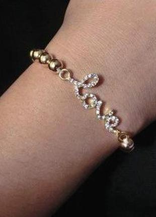 Браслет из бусин с шармом серебряного цвета с надписью love4 фото