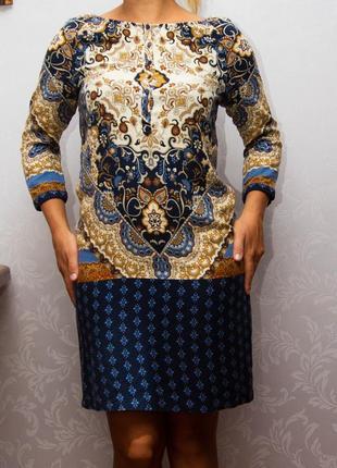Шикарное платье известного бренда.