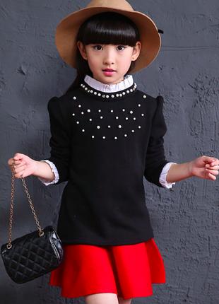 Нарядная черно-белая блузка с бусинами и оборками на 8-9 лет