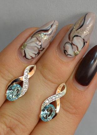 Серьги серебряные с золотом 143с голубой