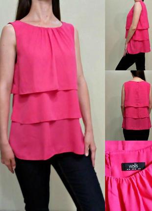 Розовая блуза с воланами
