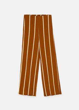 Неймовірні брюки клеш / полосатые штаны высокая посадка тренд