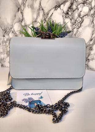 Необыкновенно красивая сумочка голубого цвета7 фото