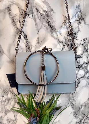 Необыкновенно красивая сумочка голубого цвета8 фото