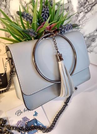 Необыкновенно красивая сумочка голубого цвета9 фото