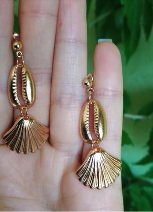 Серьги ракушки ракушка каури ракушки сережки золото1 фото