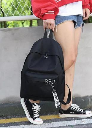 Новый черный стильный рюкзак с пирсингом