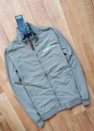 Новая с бирками мужская куртка - ветровка ветровка серая , l размер.