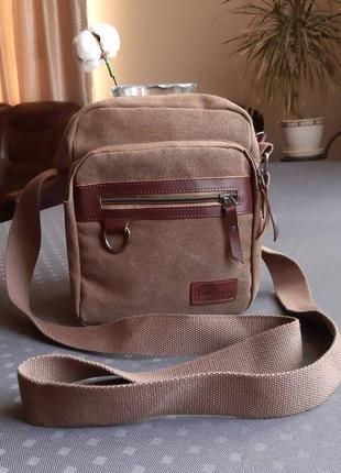 Красивая мужская сумка кроссбоди фирмы jing ling di в новом состоянии