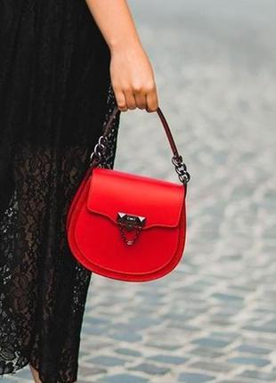 Кожаная сумочка с замшевыми вставками.