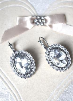 Сережки в сріблі з білим камнем1 фото