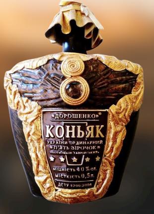 Коллекционная керамическая бутылка 0.5 л, декор натуральной кожей.